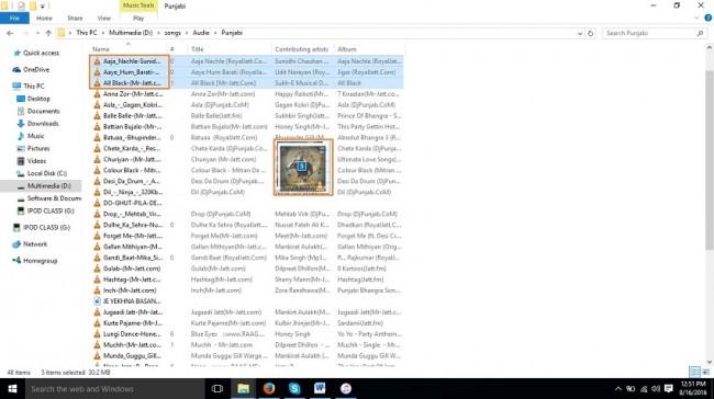 Cómo poner música en el iPod shuffle-selecciona la música y arrástrala a iTunes